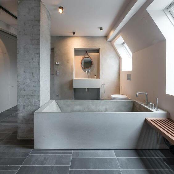 baignoire, murs et lavabo en béton ciré